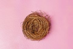 Empty nest. Over pink color background stock image