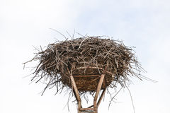 Empty nest of storks on lamppost Stock Images