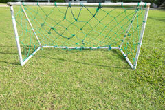 Empty net soccer goal football green grass field. Sunny day outdoors Royalty Free Stock Photography