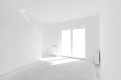 Empty new apartment for interior arrangement. Window light Royalty Free Stock Photos
