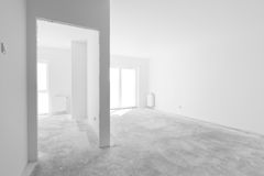 Empty new apartment for interior arrangement. Windows light Royalty Free Stock Photos