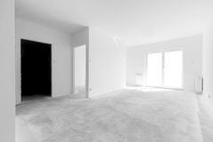 Empty new apartment for interior arrangement. Windows light Stock Photos