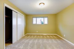 Empty new bedroom with green walls interior. Stock Photos