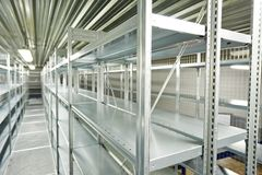 Empty new modern shelves in warehouse stock photography