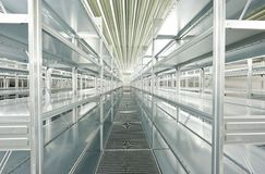Empty new modern shelves in warehouse Stock Image