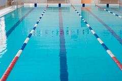 Empty new school swimming pool surface Royalty Free Stock Photo