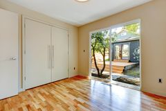 Empty nice room with hardwood floor and large doors. Royalty Free Stock Images