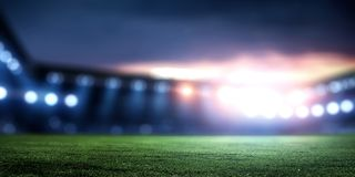 Empty night football arena in lights. And flashes stock images