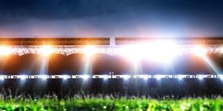 Empty night football arena in lights. And flashes stock photography