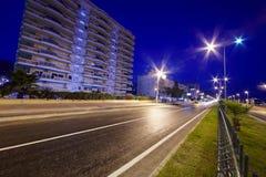 Empty night illuminated road Stock Photography