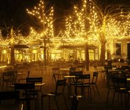 Empty night restaurant, lot of tables and chairs with noone, mag Royalty Free Stock Photo