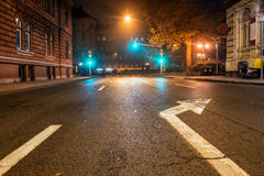 Empty night road with traffic lights Stock Photo