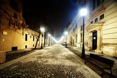Empty Night Street in Bucharest. Fantastic night scene of an empty street with street lamps in the historical Center of Bucharest, near Stavropoleos Monastery Stock Image