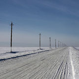 Empty northern winter road Royalty Free Stock Images