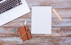 Blank note pad paper with copy space, office desk flat lay. Empty note book with blank space on paper, pencil for writing, grunge office deskt flat lay shot from Stock Photo