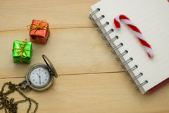 Empty note book,clock and christmas accessory put on wooden back Stock Photo