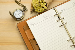 Empty note book,pocket watch and christmas accessory put on wood Royalty Free Stock Photos