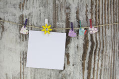 Empty note hanging with a clothespin Royalty Free Stock Image