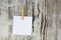 Empty note hanging with a clothespin Royalty Free Stock Photos