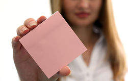 Empty note pad in the hand. Girl with empty note pad in the hand Royalty Free Stock Photography