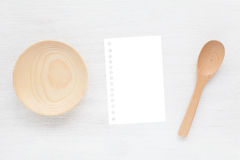 Empty note paper and kitchen utensils Royalty Free Stock Photos