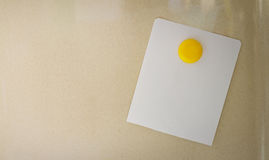 Empty note paper sheet on refrigerator door,The colors notepate Royalty Free Stock Photo
