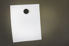 Empty note placed with a magnet on metal board Stock Images