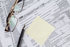 Empty note with tax form Royalty Free Stock Photo