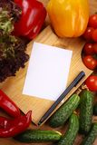Empty note and vegetables Stock Images