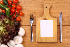Empty note and vegetables Royalty Free Stock Photo