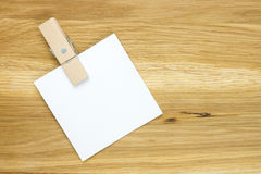 Empty note on wooden surface Stock Images