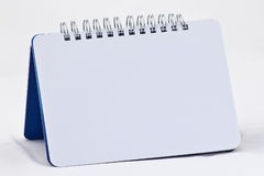 Empty notebook. Empty spiral notebook in white background Royalty Free Stock Images
