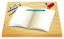 An empty notebook above the wooden table Royalty Free Stock Image