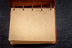 Empty notebook on black Stock Image