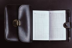 empty notebook with a black bag stock photos