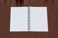 Empty notebook with  brown wood background Royalty Free Stock Image
