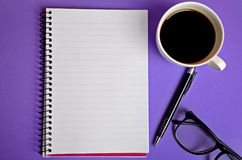 Empty notebook with coffee cup Stock Photos