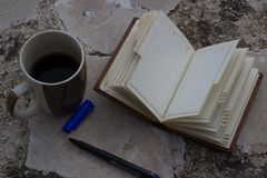 empty notebook and coffee cup and pen with copy space royalty free stock photo