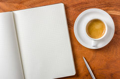 Empty notebook on a desk Stock Images