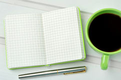 Empty notebook with fountain pen and coffee cup Stock Images
