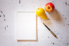 Empty notebook with fruits and pen Royalty Free Stock Image