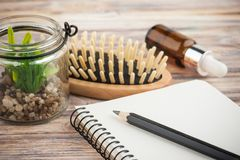 Empty notebook, hair brush stock images
