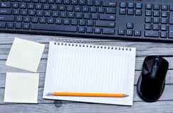 Empty notebook with keyboard pc mouse and notes Royalty Free Stock Photos