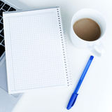 Empty Notebook on Laptop with Coffee in Office Royalty Free Stock Photos