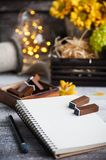 Empty notebook with lit lights and chrysanthemum stock images