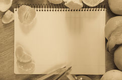 Empty notebook pages and tangerines Stock Photos