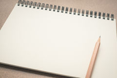 Empty notebook paper with brown pencil on the table Royalty Free Stock Photo