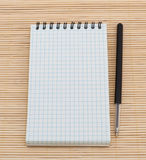Empty notebook and pen Stock Images