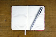 Empty notebook with pen Royalty Free Stock Images
