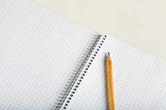 Empty notebook and pencil. A photo of a pencil on the empty notebook Stock Photos